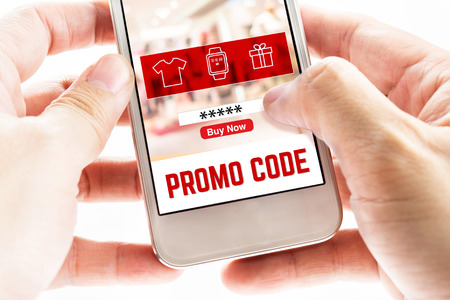 up code: Close up Two hand holding mobile phone with Promo code page and icons, Internet Marketing concept.