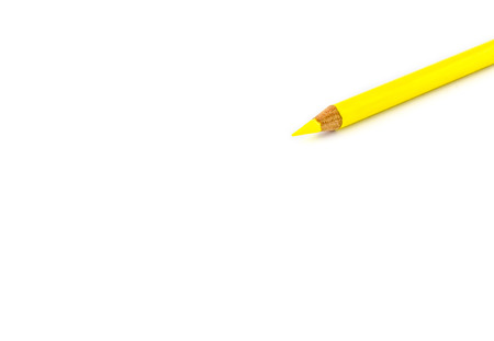 adding: yellow pencil laying on white background,leave space to adding content. Stock Photo