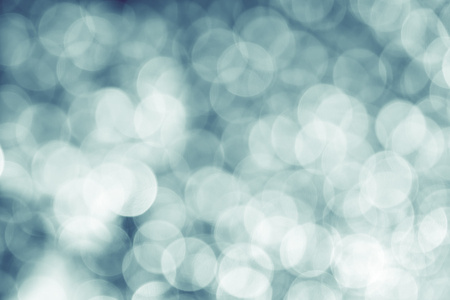 lighting effects: Abstract pale blue blur background with circle bokeh light,vintage filter. Stock Photo