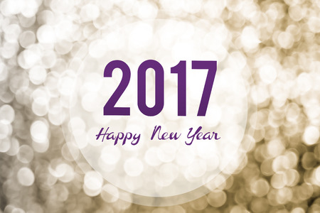 holiday greeting: Happy new year 2017 on golden bokeh light background,Holiday greeting card.