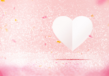 room for your text: Paper white heart floating at pastel pink sparkling glitter room with confetti paper,Valentines day card ,Leave space for adding your text,Love concept.