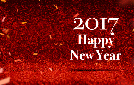 new year's card: happy new year 2017 at perspective red sparkling glitter with gold confetti,Holiday greeting card design.