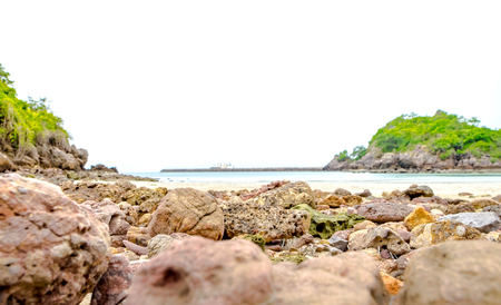 close up view: close up sea rock at beach with blur sea line background,low angle view Stock Photo