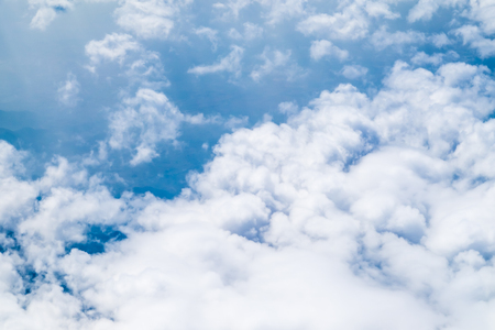 Aerial view of cloud and sky from airplane,Traveling concept.