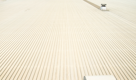 commercial building: Perspective view of metal sheet roof with air ducts. Stock Photo