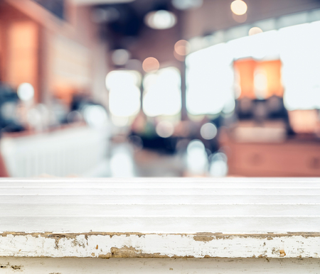 furniture store: Grunge white empty table top at blur kitchen background, Mock up template for display or montage of product,Business presentation. Stock Photo