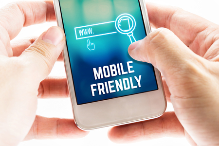 close icon: Close up Two hand holding mobile phone with mobile friendly and search icon, Digital Marketing concept.