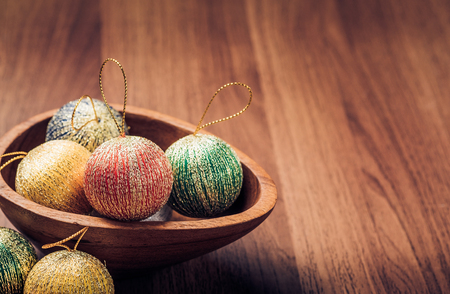 adding: Christmas decoration balls on wooden table top,winter holiday still life,vintage filter, Leave space for adding text.