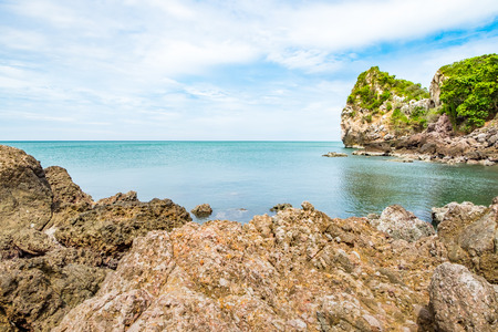 Landscape view of rock coast at blue sea and sky in thailand.