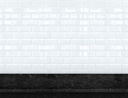 Empty black marble table top with glossy ceramic white tile wall,Mock up for display or montage of product.