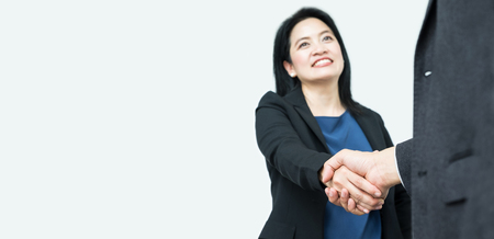 business in hand: Smile Business woman handshake with businessman,Focus on hand,Mock up banner for adding your text or design,Partnership concept.