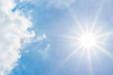 blue ray: looking up at white cloud and sun ray with blue sky.