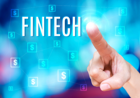 e commerce: Finger point to Fintech word with bitcoins icon link network together on blue abstract background,Digital Financial business concept. Stock Photo