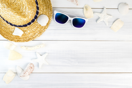 vacation summer: Summer Beach accessories (White sunglasses,starfish,straw hat,shell) on white plaster wood table top view,Summer vacation concept,Leave space for adding text. Stock Photo