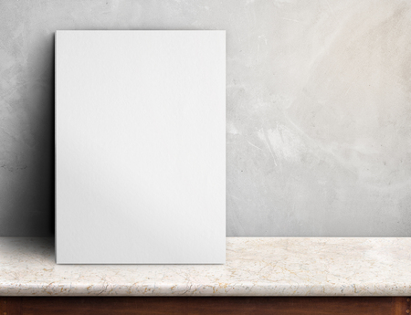 beside: Blank White paper poster on black marble table at grey concrete wall,Template mock up for adding your design and leave space beside frame for adding more text