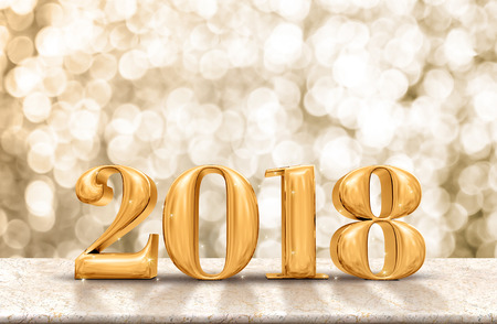 Happy New Year 2018 gold glossy on marble table with sparkling gold bokeh wall,Holiday celebration concept.