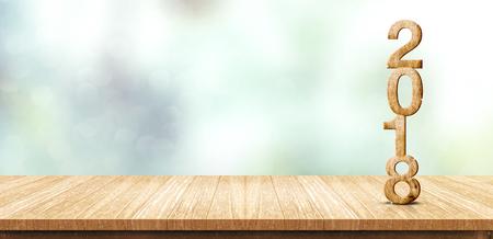 New year 2018 wood number (3d rendering) on wooden plank table at blur abstract green bokeh background,Mock up banner space for display or montage of product,business presentation.