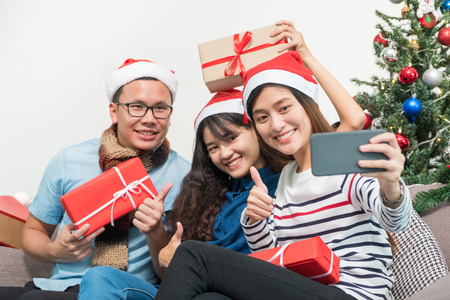 Christmas party with friends, asia woman selfie with smiling face with friends,Holiday celebration concept