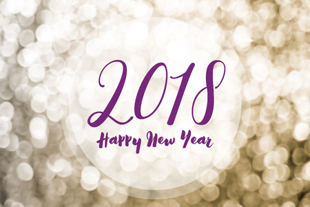 Happy new year 2018 on golden bokeh light background,Holiday greeting card.