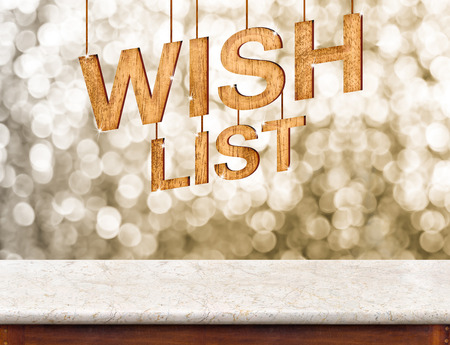 Wish list wood texture with sparkle star hang on marble table with sparkling gold bokeh wall,winter festive holiday celebration greeting card