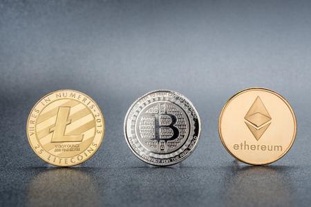 Cryptocurrency Lite coin,Silver Bitcoin,Ethereum on black background,Digital cryto currencies.Virtual money Foto de archivo