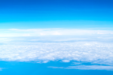 Blue sky and Cloud Top view from airplane window,Nature background Stock Photo