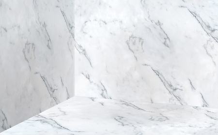 Empty white glossy marble corner studio room background,Mock up template for display or montage of product or design,Online marketing media.