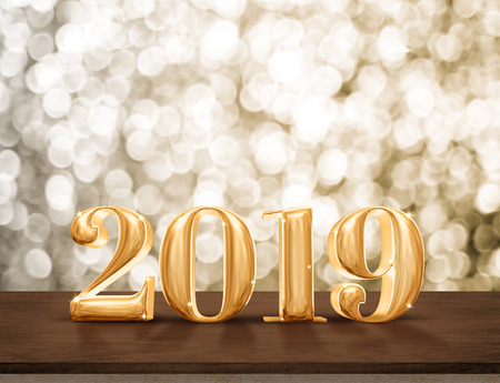 Happy New Year 2019 gold glossy with sparkling star on dark brown table with gold bokeh wall,Holiday festive celebration concept.copy space for display of text or content