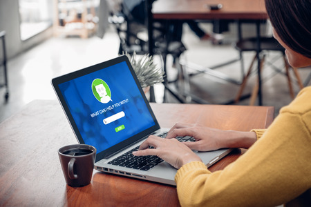 Asia woman ask chat bot function in app on laptop screen looking for customer support online shopping shop with apps,digital marketing concept,artificial intelligence (ai) system