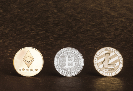 Cryptocurrency litecoin,Silver Bitcoin,Ethereum on golden rough background,Digital cryto currencies.Virtual money Stock Photo