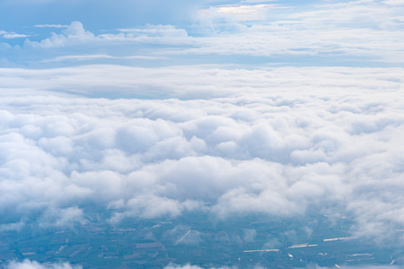 Big Blue sky and Cloud and city under cloud Top view from airplane window,Nature background