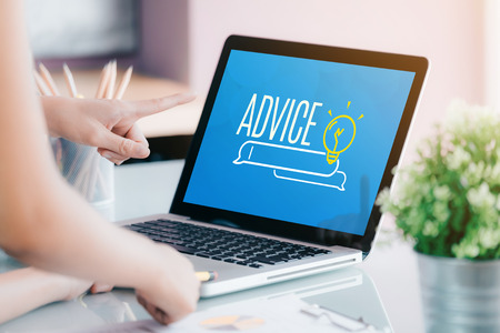 Close up businesswoman hand point at laptop screen with advice funciton on screen at office.business expert advice solution concept