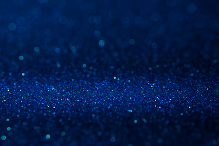 Abstract dark vivid navy blue sparkling glitter wall and floor perspective background studio with blur bokeh.luxury holiday backdrop mock up for display of product.holiday festive greeting card Banque d'images