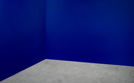 Empty corner navy blue wall and grey concrete floor perspective room,Modern style room,Mock up for display of product,business presentation Stock fotó