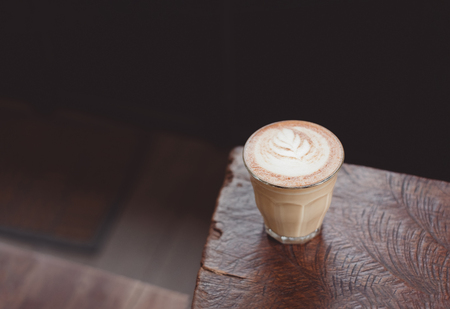 hot cappuccino coffee cup on wooden tray with latte art on wood table at cafe.food and drink concept Standard-Bild - 112242673