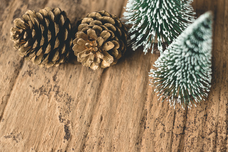 Top view of Christmas tree and gold pine cone on grunge wood table.winter holiday greeting card.leave space for adding text Standard-Bild - 112678537