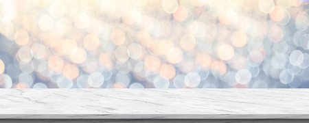 Empty white marble glossy table top with blur sparkling soft pastel blue and orange bokeh abstract background,panoramic banner for display or montage of product,Holiday seasonal concept backdrop Standard-Bild - 113445018
