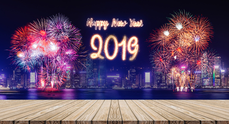 Happy new year 2019 fireworks over cityscape at night with empty wood plank table top,Banner mock up template for display or montage of product for holiday promotion advertising Standard-Bild - 113445024