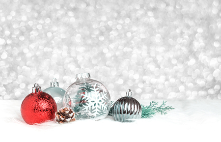 Christmas decoration ball on white fur at silver bokeh light background,Holiday greeting card. Standard-Bild - 113445056