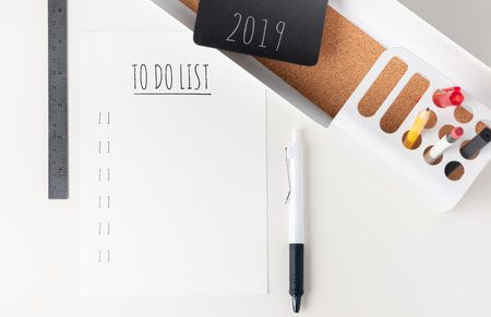 Top view to do list 2019 paper note on modern office stationery on white table.pencil, notepad,ruler,pen and pencil box with plant.Mock up paper note for display of design or content Standard-Bild - 113445059