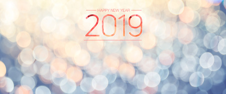 Happy new year 2019 banner with pale yellow and blue bokeh light sparkling background,Holiday greeting card Standard-Bild - 113445069