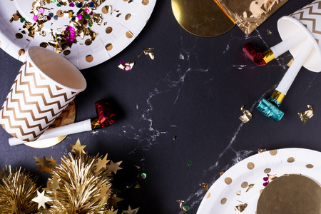 party cup,party blower,tinsel,confetti.Holiday celebrate party time.top view tabletop. Standard-Bild - 113445072