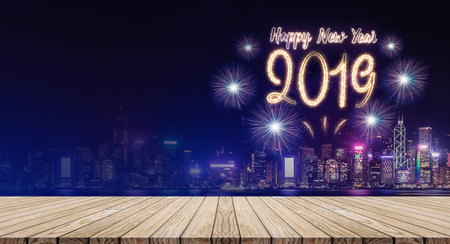 Happy new year 2019 fireworks over cityscape at night with empty wood plank table top,Banner mock up template for display or montage of product for holiday promotion advertising Standard-Bild - 113445078