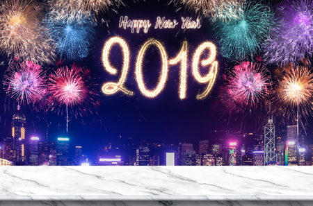 Happy new year 2019 fireworks over cityscape at night with empty white marlbe table,Banner mock up template for display or montage of product for holiday promotion advertising Standard-Bild - 113445223