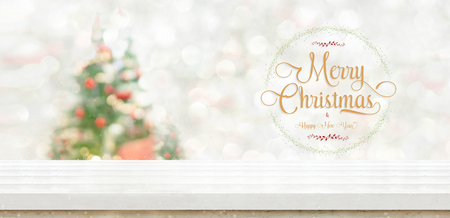 Merry christmas and happy new year wreath at White wood table top at blur bokeh christmas tree decor with string light background when show falling,Winter holiday greeting card Standard-Bild - 113793796