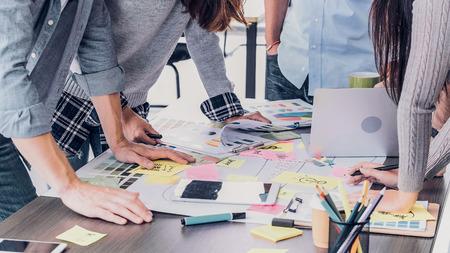 Close up creative designer applaud for job success at meeting table at office Standard-Bild - 118844768