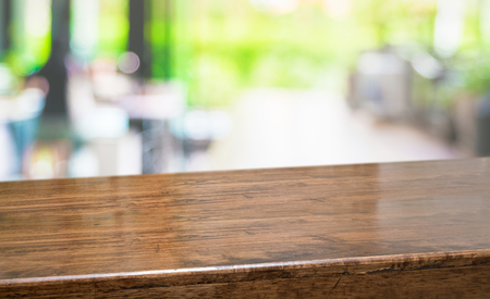 Empty perspective hardwood table with blur kitchen in garden background bokeh light,Mock up for display or montage of product,Banner or header for advertise on online media Standard-Bild - 118844707