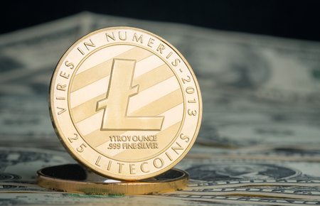 crypto currency gold litecoin on dollar banknote background.Virtual digital money concept.financial business. Standard-Bild - 118844709