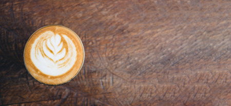 Top view of hot cappuccino coffee cup on wooden tray with latte art on wood table at cafe,Banner size food and drink concept.leave copy space for adding text Standard-Bild - 118844714