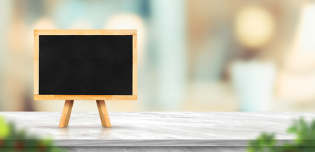 Blackboard on white marble table and blurred soft light table in luxury restaurant with bokeh background. product display template.Business presentation Standard-Bild - 118844642